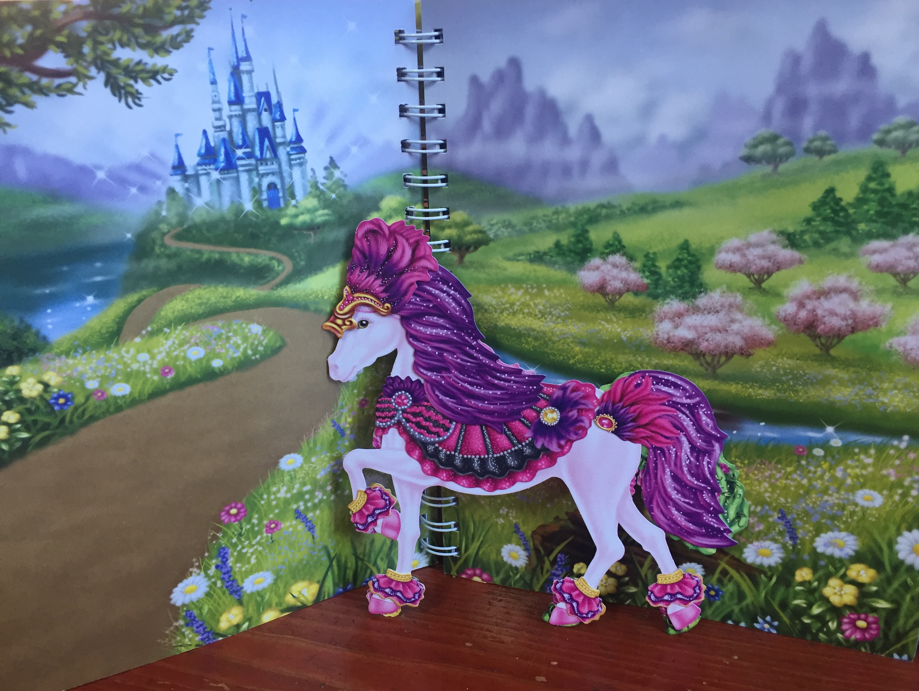 Scene and paper horse dressed up from The Marvelous Book of Magical Horses by Klutz
