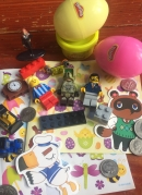 Play-doh Easter eggs Tom Nook Animal Crossing sticker Lego figures and pieces Hermione Grainger Harry Potter miniature figure coins