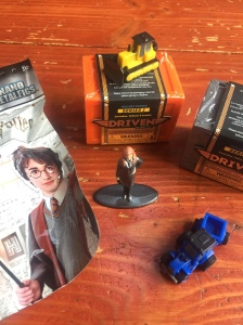 Harry Potter figure blind bag and Hermione Grainger figure Driven Pocket Series garages bulldozer and blue tractor with trailer attached