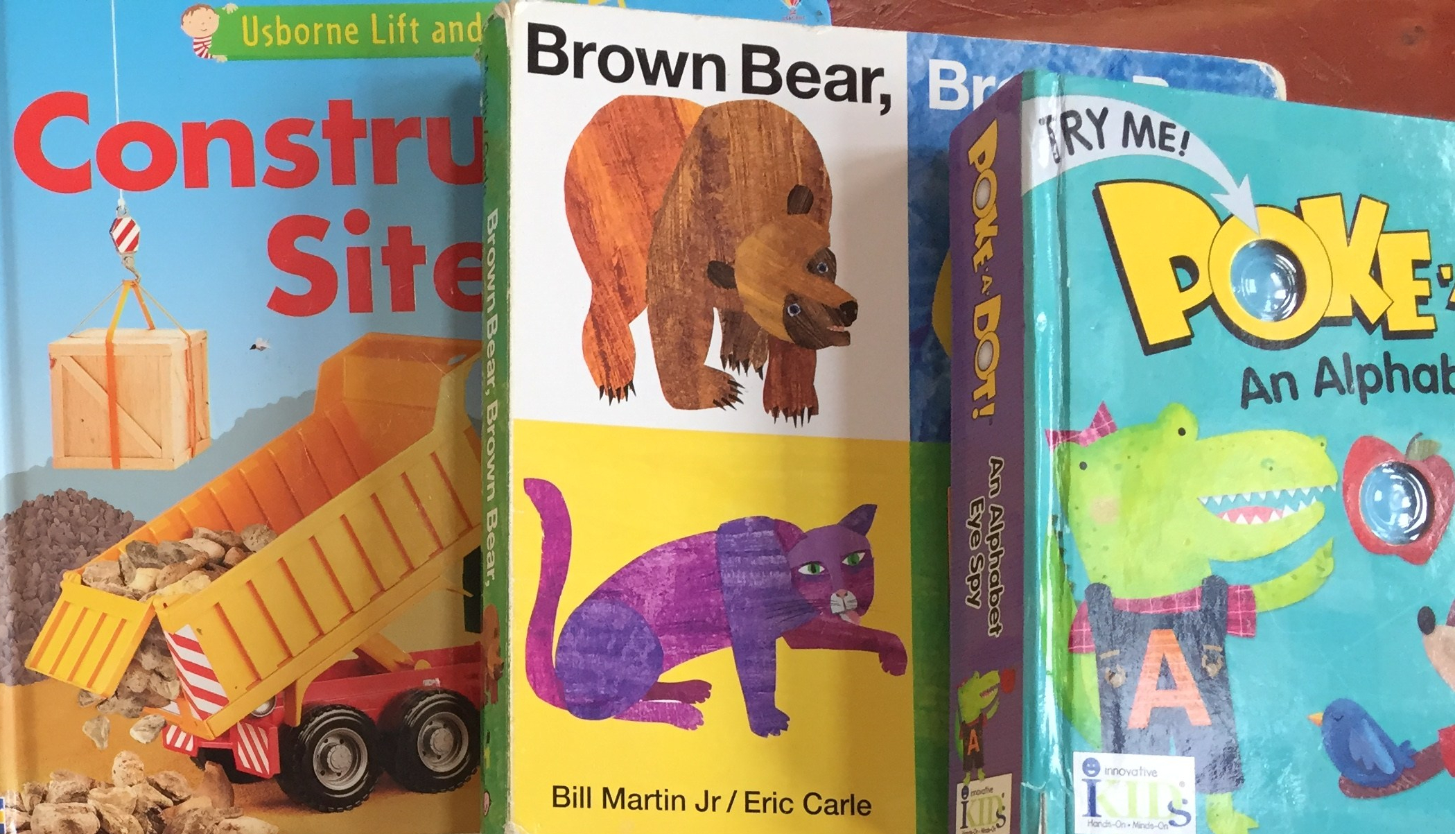 Usborne Lift and Look board book construction site Brown Bear Brown Bear What Do You See slide and find board book and Poke-a-dot