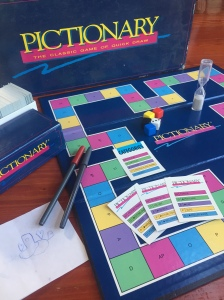 Pictionary game with board, die, cards, a