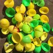 Green and yellow Easter eggs emptied on ground in pile