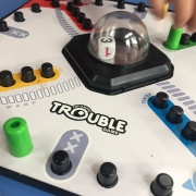 Trouble board game for kids with die in plastic bubble