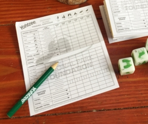 Yahtzee scoring sheet with pencil and dice