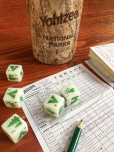 Yahtzee family dice game National Parks edition with shaker, dice, pencil, and scoring sheet
