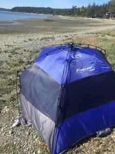 Lightspeed pop up tent set up on rocky beach