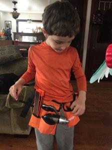 Six year old wearing Rexbeti 15 piece kids tool belt