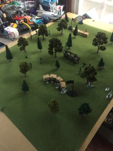 Miniature battle scene set up on cardboard
