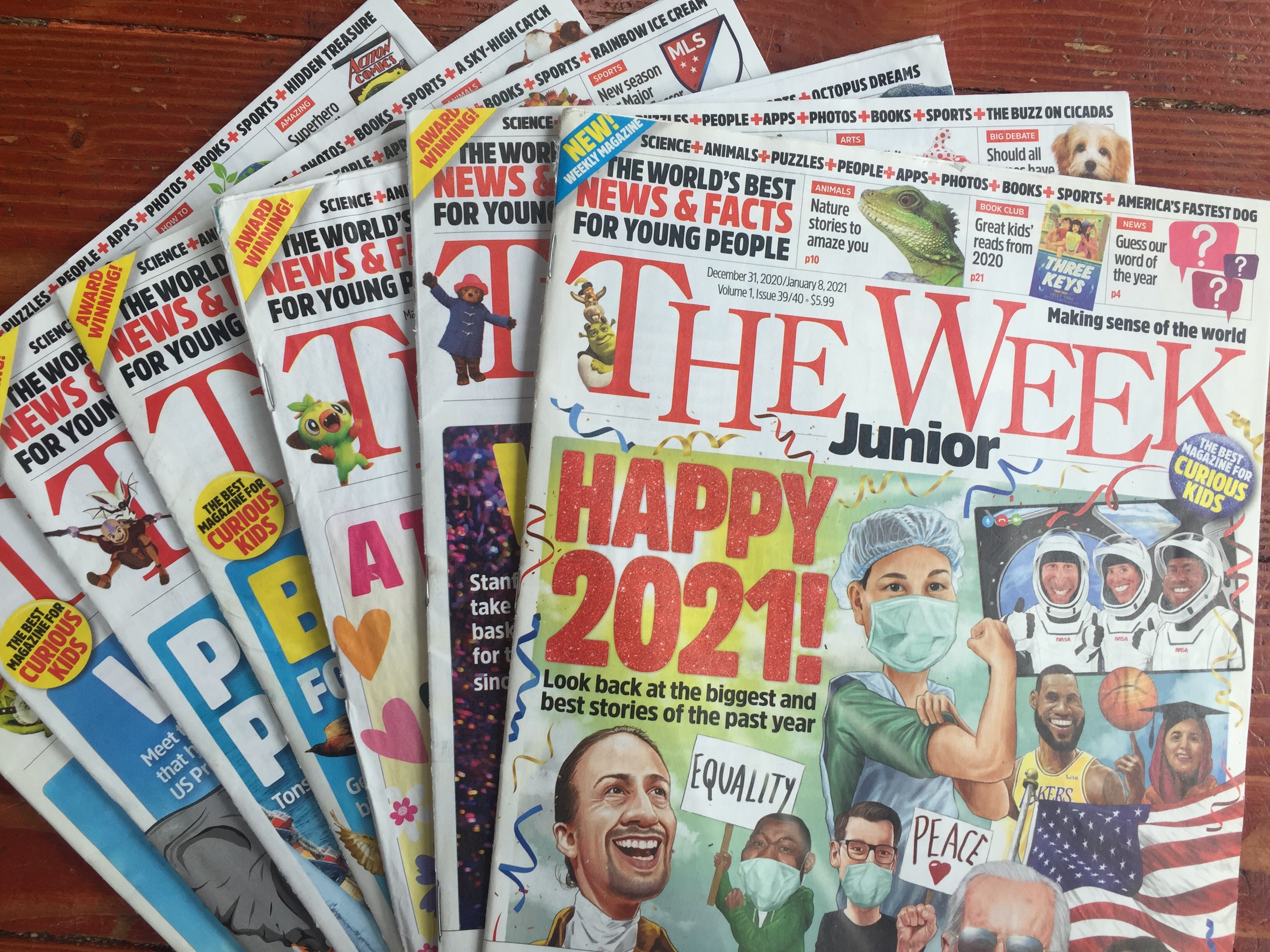 The Week Junior magazine for kids multiple issues from 2021 fanned out on floor