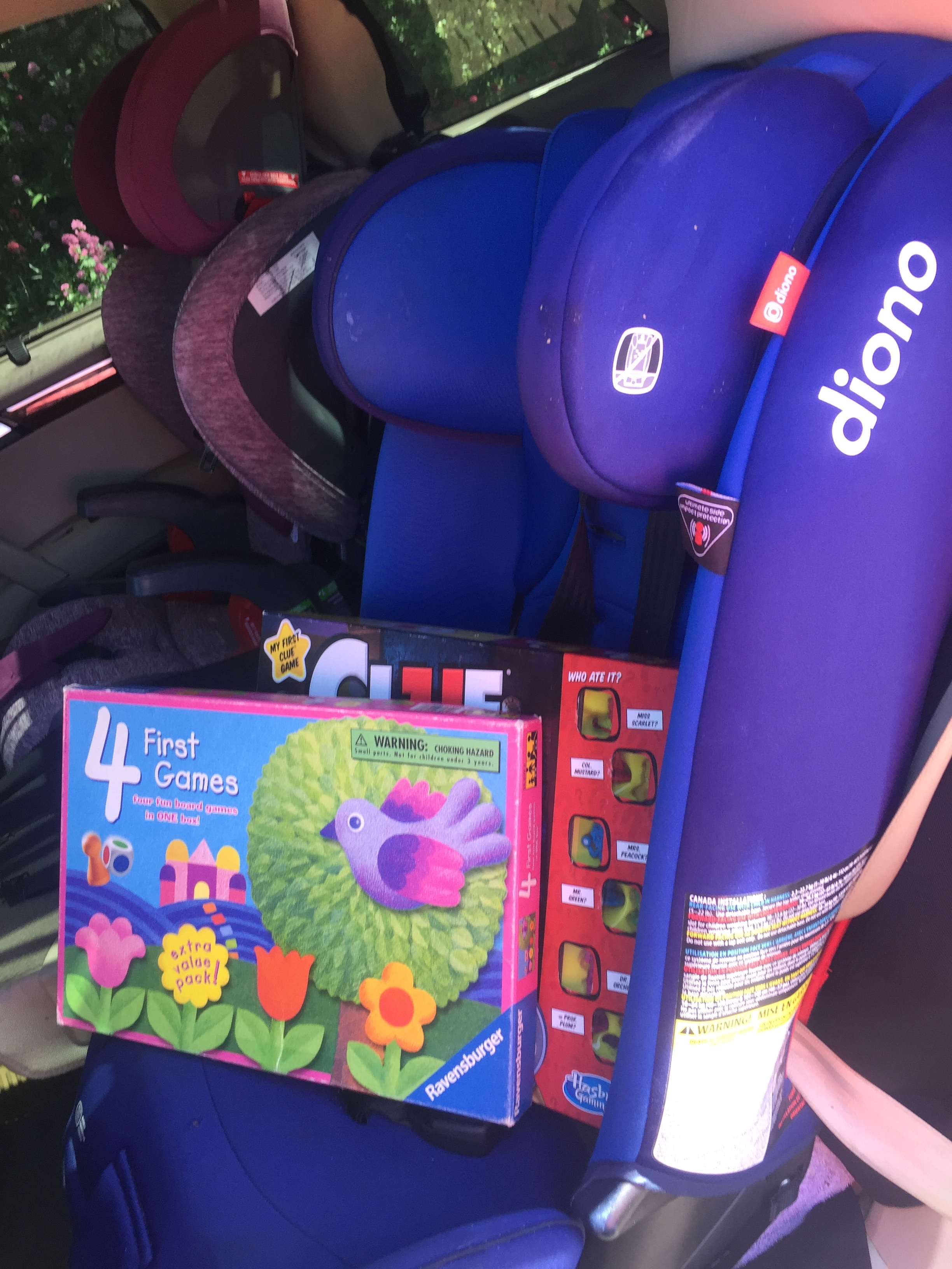 Diono Radian 3RXT convertible car seat in blue with Ravensburger Four First Games and Clue Junior