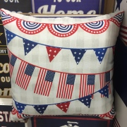 Festive pillow covered in American flags and red white and blue bunting for Fourth of July