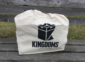 Kingdoms Lawn Game in carrying bag on bench