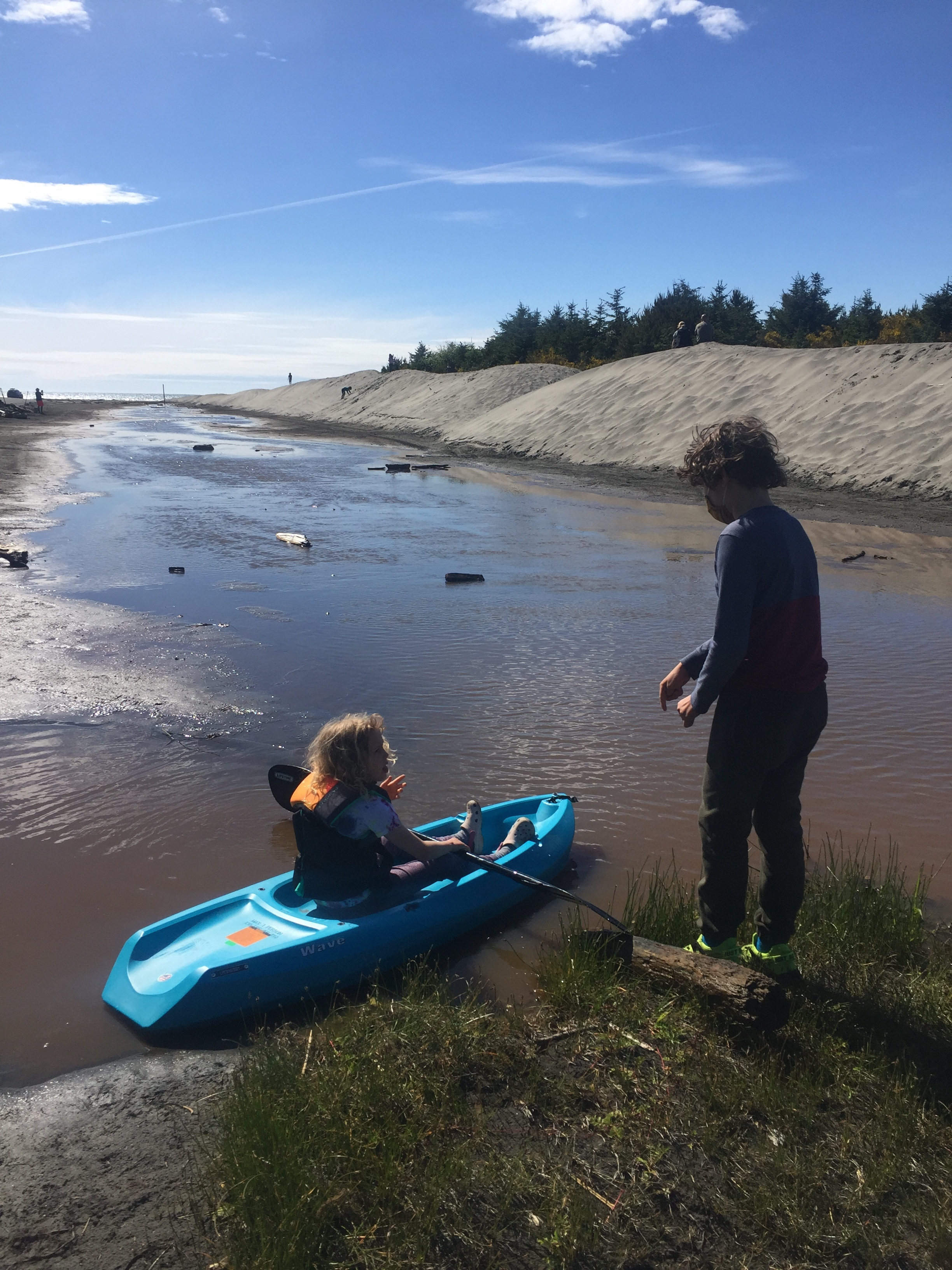 Lifetime Wave Youth Kayak in blue with child paddling on sandy creek bed