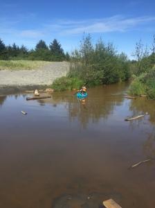 Child paddling around in blue Lifetime Wave youth kids kayak