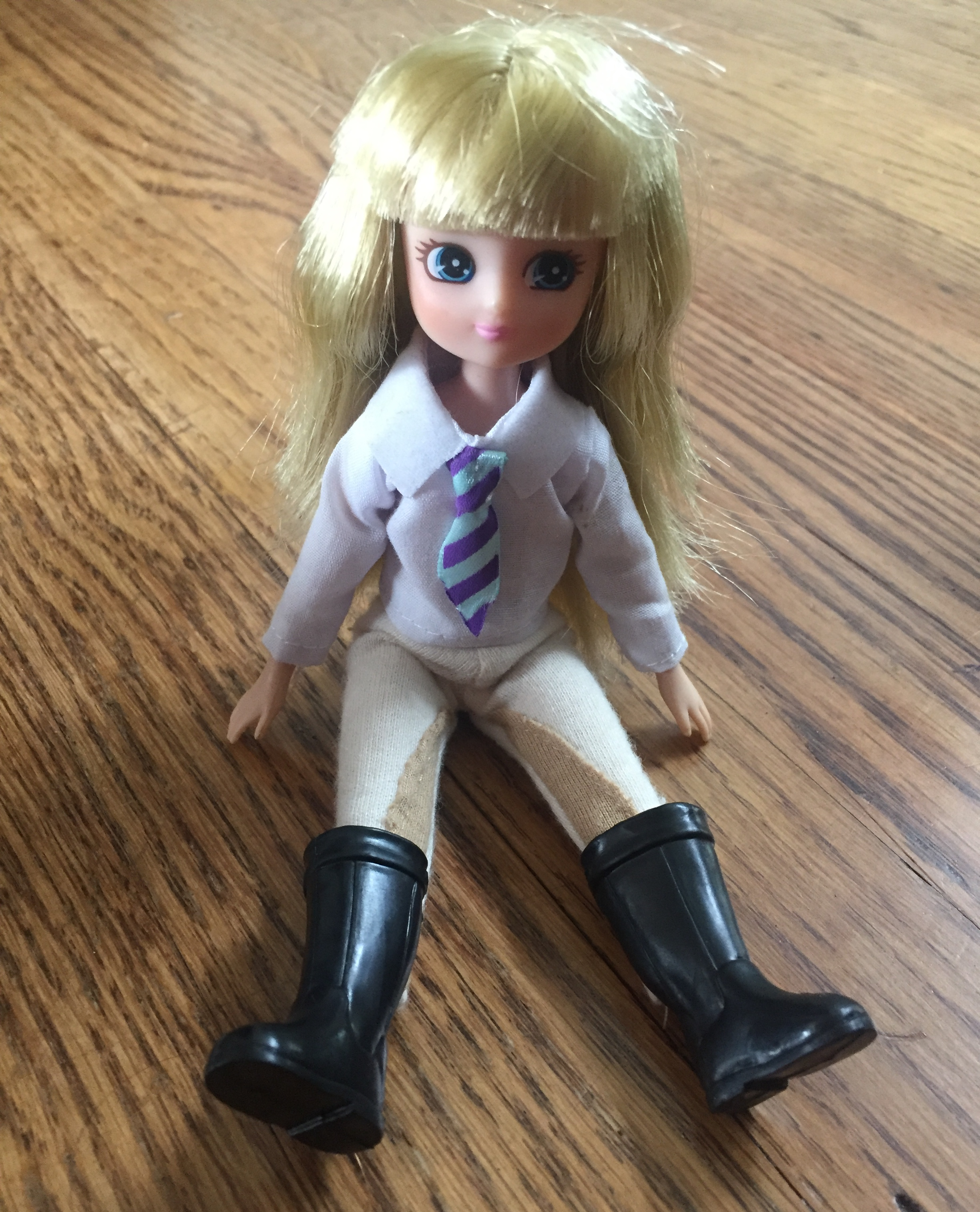 Lottie Dolls Pony Pals Olivia doll in riding clothes and boots sitting down