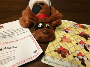 Pound Puppy Newborn stuffed animal brown with black spots with adoption certificate and sheet showing different patterns, colors, and styles