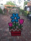 Make Your Own Suncatchers Window Art flowers in flower pot hanging on door window to patio