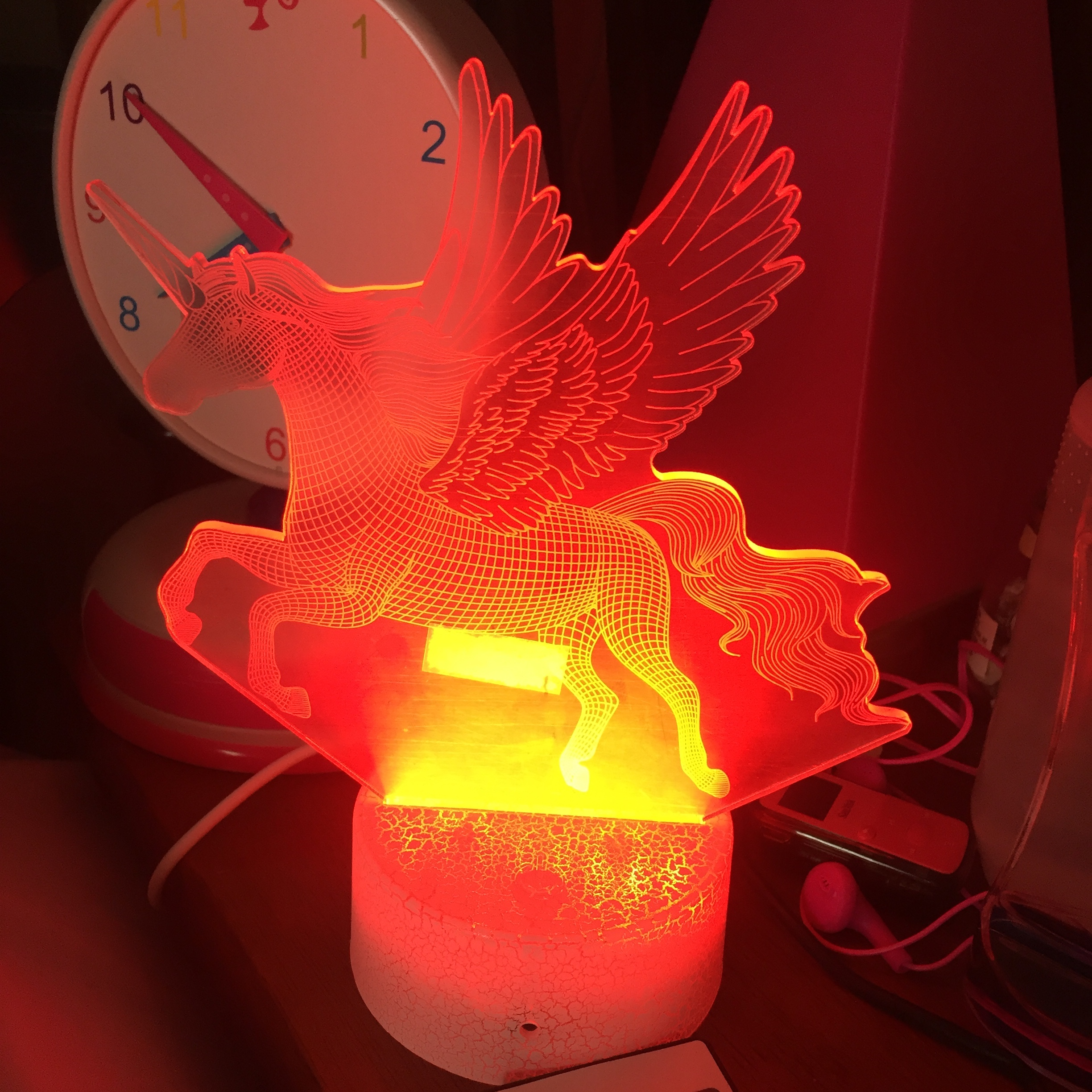 Unicorn Night Lamp Light for kids 3D changes colors shown in red fading to orange and yellow