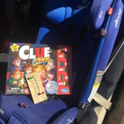 Diono Radian 3RXT convertible car seat in blue with Clue Junior and football peg game sitting in it