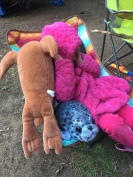 Child sitting with stuffed animal and hot pink fleece jacket in Alite Designs Mayfly Chair