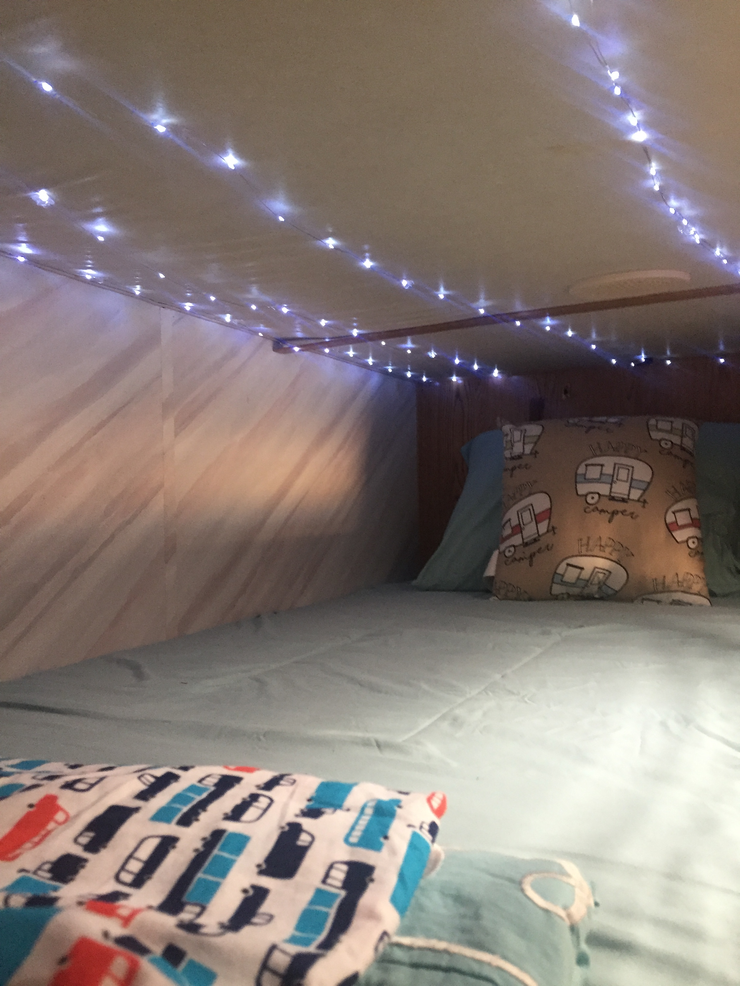 Fairy lights for kids installed on ceiling of top bunk of RV travel trailer