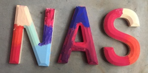 Wooden letters painted in bright colors by kids
