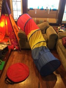 Pop up tunnel toy for young kids on furnit