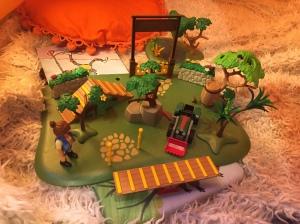 Child's Playmobil set up on fluffy carpet