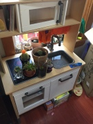 IKEA play kitchen for kids transformed into garden center potting bench for kids