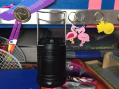Magnetic knife rack attached to side of child's bed holding pretend coin money, lantern, key chains