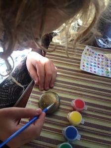 Child painting rock from Joyeza rock painting kit