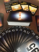 The Mind card game by Pandasaurus games number cards fanned out in front of deck