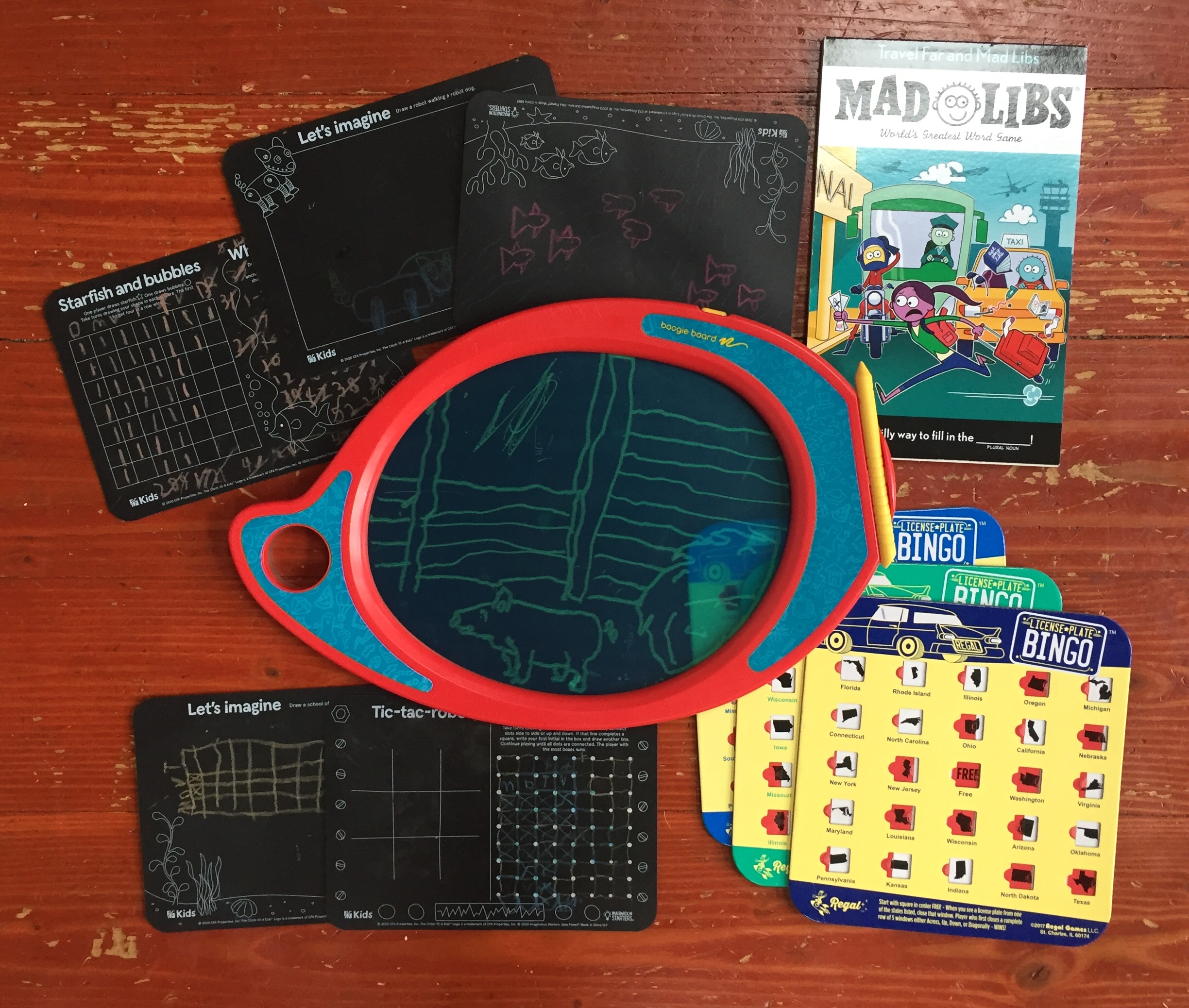 travel entertainment for kids Boogie drawing board, Mad Libs travel edition, license plate bingo boards, small chalkboard placemats